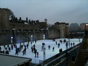 Ice skaters in front of the Tower of London, with the Norman Foster-designed City Hall in the background